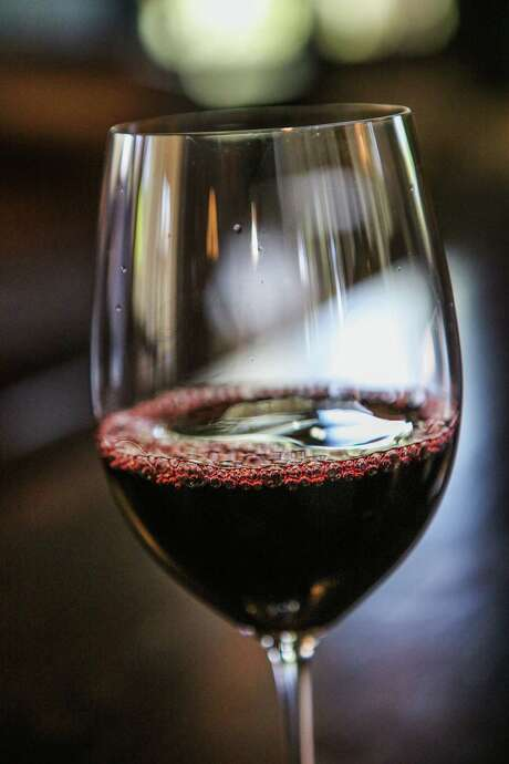 A freshly poured glass of red wine sits on the table of the tasting room at Harlan Estate, in Napa, California, on Tuesday, April 19, 2016. Photo: Gabrielle Lurie, Freelance / ONLINE_YES