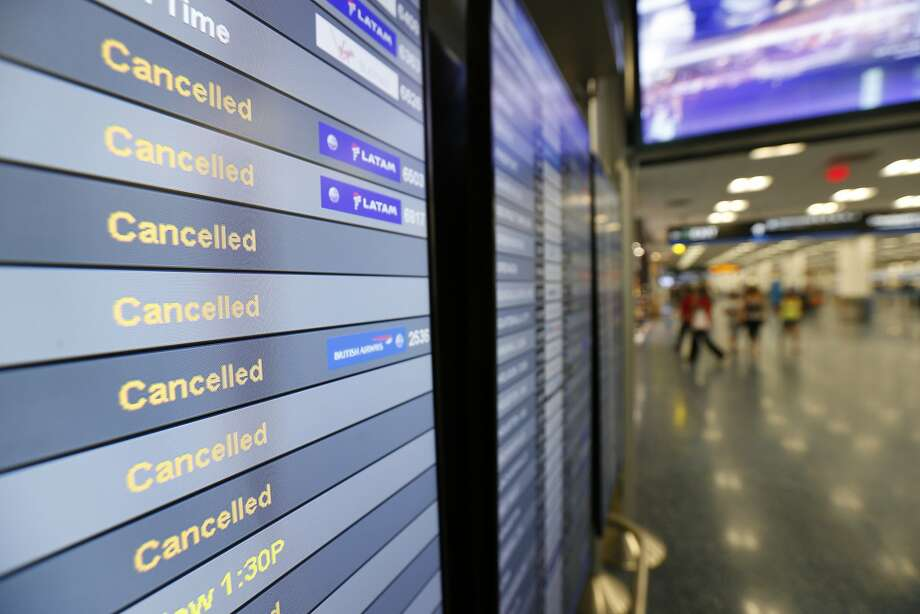 This Friday, Sept. 8, 2017, file photo, shows a monitor listing canceled flights at Miami International Airport in Miami. As of Monday, Sept. 11, 2017, airlines have canceled more flights as air travel in Florida remains grounded and Irma spins farther north.  Photo: Wilfredo Lee, Associated Press