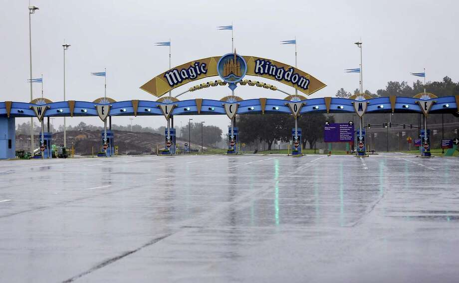 The entrance to the Magic Kingdom at Disney World is empty as the theme park was closed because of Hurricane Irma approaching the central Florida area Sunday in Lake Buena Vista, Fla. Other tourists attractions including Universal Studios and Sea World were also closed and planned to reopen Tuesday. Photo: John Raoux /Associated Press / Copyright 2017 The Associated Press. All rights reserved.