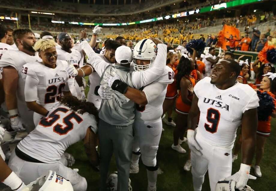 UTSA head coach Frank Wilson, center, celebrates with his players following their 17-10 win over Baylor following an NCAA college football game, Saturday, Sept. 9, 2017, in Waco, Texas. Photo: Rod Aydelotte /Waco Tribune Herald