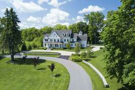 The timeless colonial house at 131 Olmstead Hill Road sits on a beautifully landscaped 2.17-acre property that borders the Wren Thicket Open Space.
