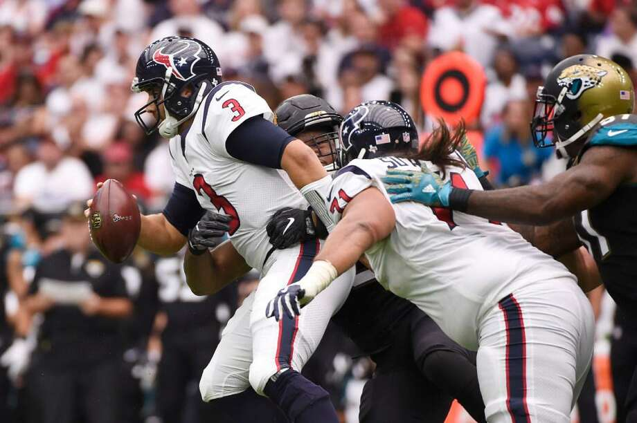 Houston Texans quarterback Tom Savage (3) is sacked during the first half of Sunday's game vs. Jacksonville in Houston. He was later benched by coach Bill O'Brien. Photo: Eric Christian Smith /AP Photo