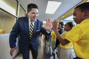 "Houston ISD Superintendent Richard Carranza gives ""High-Fives"" to students at Codwell Elementary Monday, Sept. 11, 2017, in Houston. Carranza visited the campus on the first day of school as hundreds of thousands of Houston area students have returned to their campuses since Hurricane Harvey devastated the region beginning on Aug. 26."