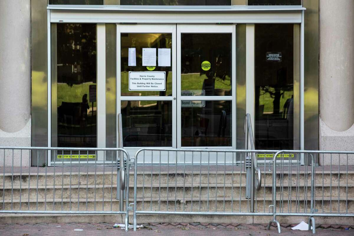 A sign announces that the Harris County Criminal Court has been closed until further notice, Monday, Sept. 11, 2017, in Houston.