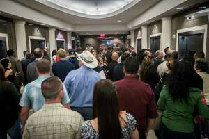 People gather by the elevators on the first floor of the Harris County Civil Court trying to make it to the upper floors of the court, Monday, Sept. 11, 2017, in Houston.
