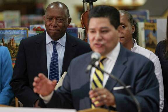 Houston mayor Sylvester Turner, left, listens as Houston ISD Superintendent Richard Carranza holds a press conference at Bryce Elementary School to discuss the school district's reopening of hundreds of facilities for the first day of school after Tropical Storm Harvey Monday, Sept. 11, 2017 in Houston.