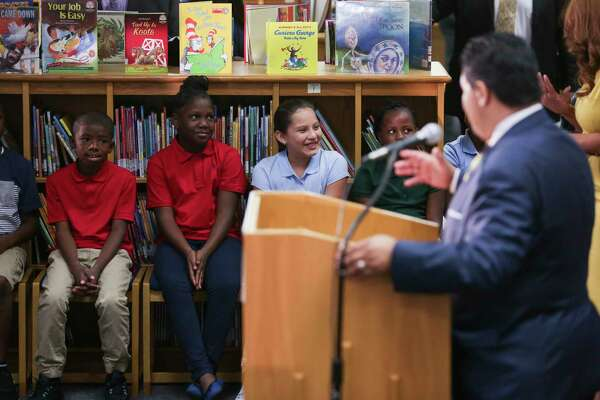 Bryce Elementary School kids listen as Houston ISD Superintendent Richard Carranza holds a press conference to discuss the school district's reopening of hundreds of facilities for the first day of school after Tropical Storm Harvey Monday, Sept. 11, 2017 in Houston.