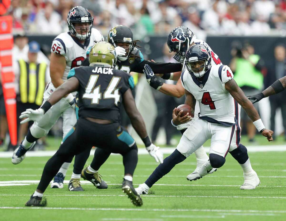 Houston Texans quarterback Deshaun Watson (4) runs the ball against Jacksonville Jaguars outside linebacker Myles Jack (44) in the fourth quarter of an NFL football game at NRG Stadium, Sunday, Sept. 10, 2017, in Houston. ( Karen Warren / Houston Chronicle )