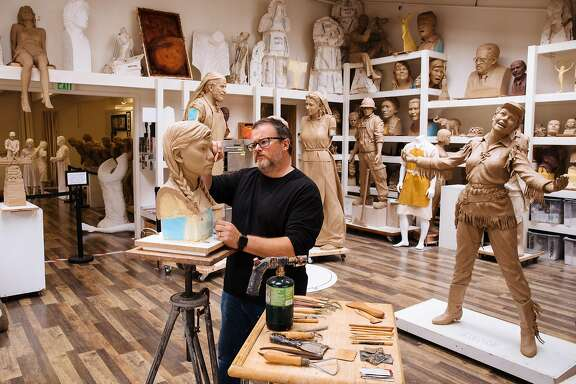 Sculptor Steven Whyte works on the face of one of the girls in the 'Women�s Column of Strength' memorial in his studio in Carmel, Calif. Friday, September 8, 2017.
