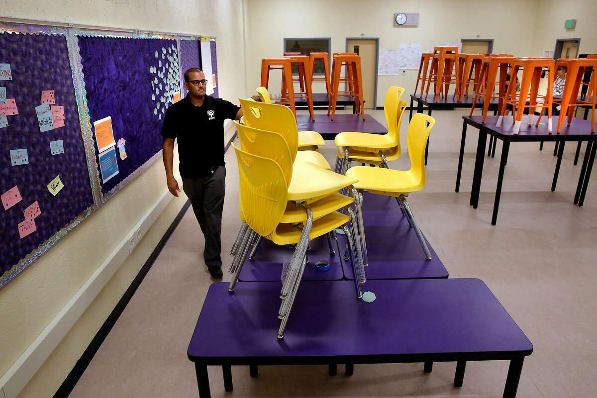 Principal Joe Truss with the new tables and chairs that now fill the collaborative learning space on the Visitation Valley Middle School campus which was made possible using the huge donations of money from Salesforce founder Mark Benioff in Francisco, Ca., as seen on Thurs. September 7, 2017.