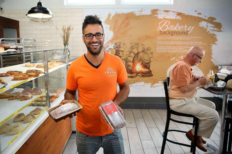 Co-founder Avi Edri shows honey cakes at Frena Bakery. Photo: Liz Hafalia, The Chronicle
