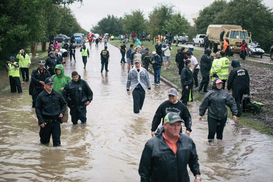 Civilians and the National Guard look for people in need of evacuation from an apartment complex in west Houston, Sept. 1. Federal aid must be dispensed efficiently and according to need. Photo: ALYSSA SCHUKAR /NYT / NYTNS