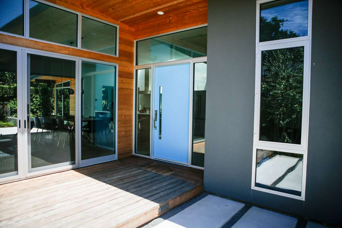The blue front door of the remodeled home of Susan Wang and James Czaja in in San Carlos on Saturday, July 15, 2017. The Czaja -Wang family moved into their home on Dec. 31, 2015 after the year and a half remodeling process.