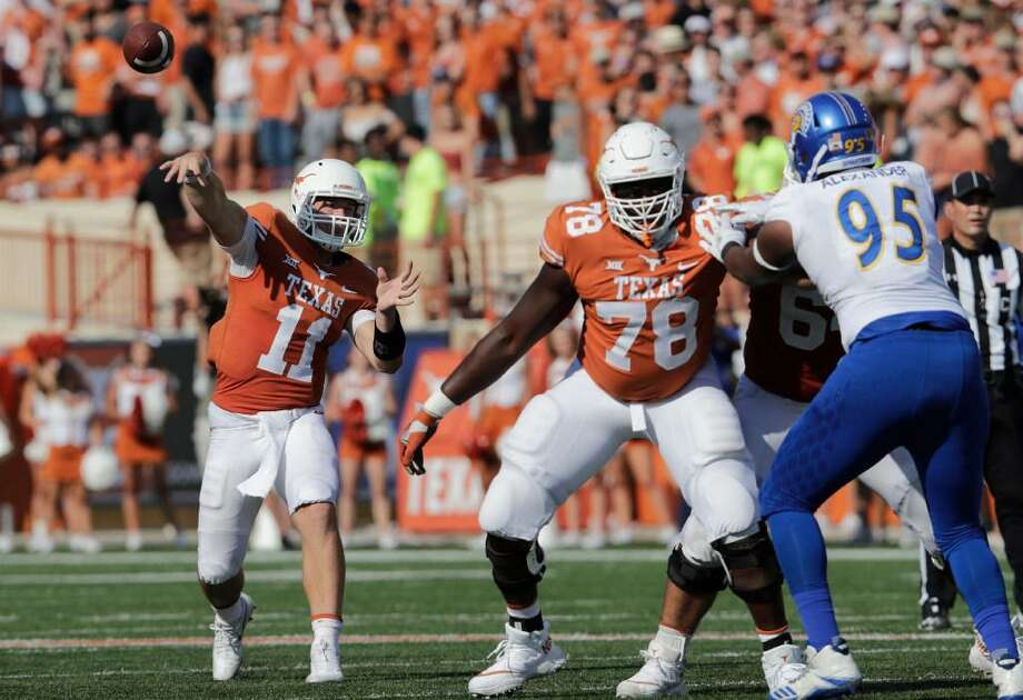 Sam Ehlinger of the Texas Longhorns throws a pass as Denzel Okafor blocks Cameron Alexander of the San Jose State Spartans Saturday at Darrell K Royal-Texas Memorial Stadium. Photo: Tim Warner /Getty Images