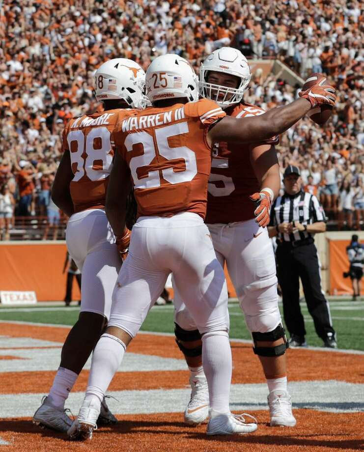 Connor Williams #55 of the Texas Longhorns congratulates Chris Warren III #25 after a touchdown in the second quarter at Darrell K Royal-Texas Memorial Stadium on September 9, 2017 in Austin, Texas. Photo: Tim Warner /Getty Images