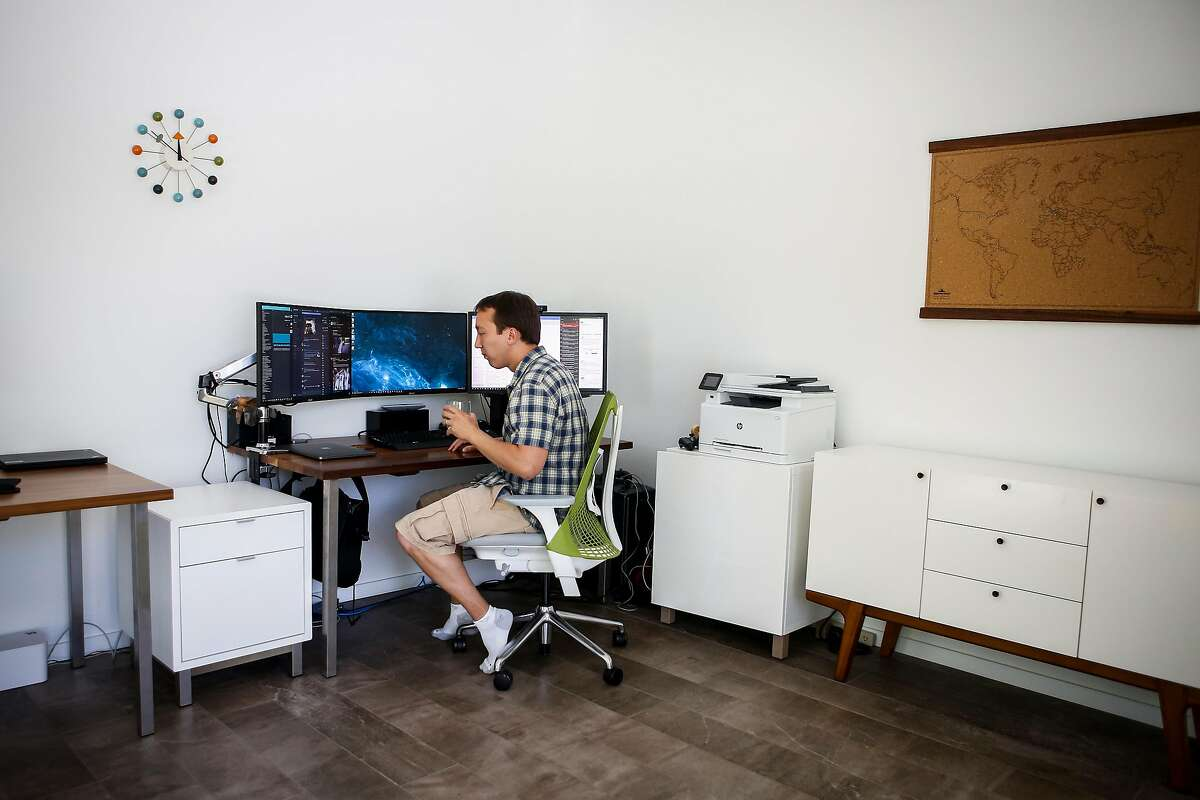 James Czaja works on his computers in the office of his remodeled home in San Carlos on Saturday, July 15, 2017. The Czaja -Wang family moved into their home on Dec. 31, 2015 after the year and a half remodeling process.