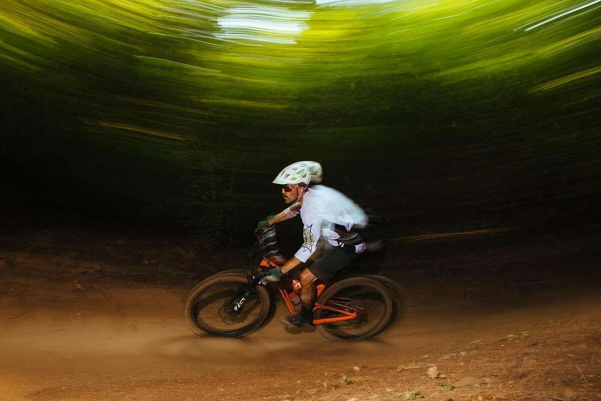 Jeremy Benson rides down the Hoot Trail near Nevada City, Calif. Tuesday, September 5, 2017.