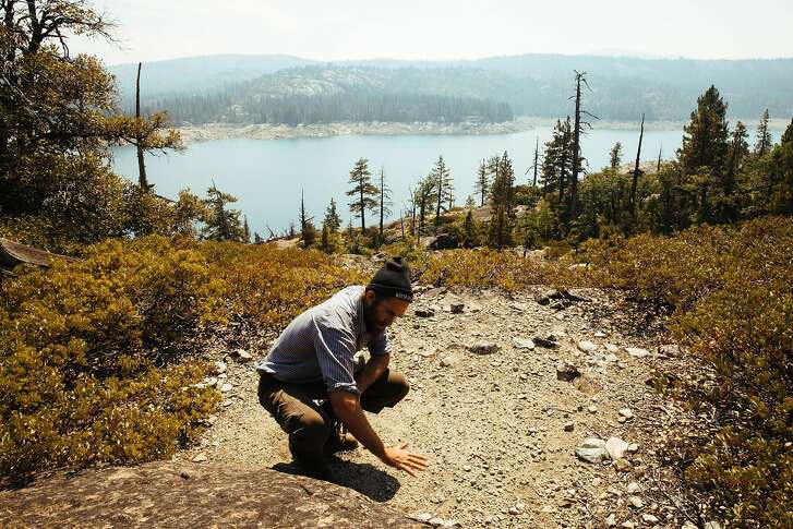 Truk Jantz, founder of Conscious Course, shows how he builds his oven and kitchen on the flat rocks near Lake Spaulding in Nevada City, Calif. Tuesday, September 5, 2017.