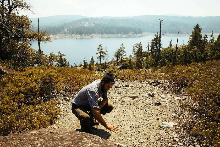 Truk Jantz, founder of Conscious Course, shows how he builds his oven and kitchen on the flat rocks near Lake Spaulding in Nevada County. Photo: Mason Trinca, Special To The Chronicle