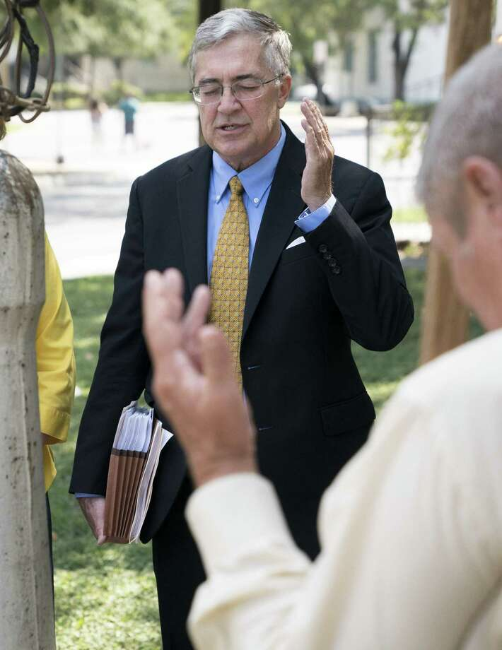 Allan E. Parker, president of The Justice Foundation, leads a prayer circle around a flag pole before a press conference about the recent change SAISD made to its non-discrimination statement, Monday, Sept. 11, 2017, at San Antonio Independent School District's Burnet Center in San Antonio. The statement now says students and employees are protected from discrimination based on sexual orientation, gender identity or gender expression. (Darren Abate/For the Express-News) Photo: Darren Abate, FRE / Darren Abate/Express-News / San Antonio Express-News