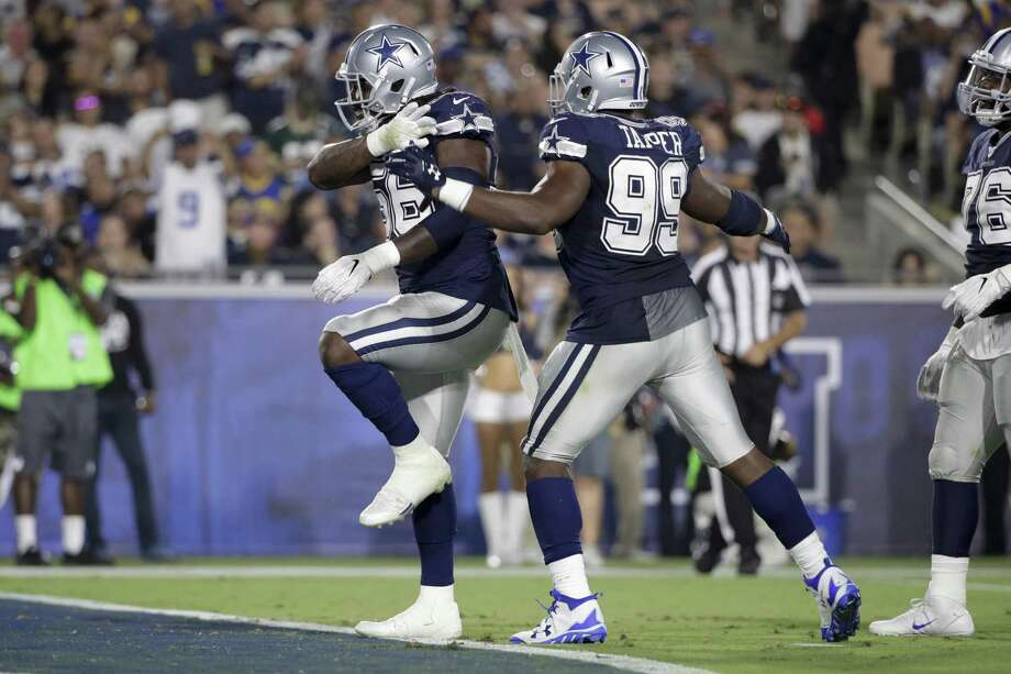 Dallas Cowboys defensive end Lenny Jones (56) celebrates a sack with teammate defensive end Charles Tapper (99) during the second half of a preseason NFL football game against the Los Angeles Rams Saturday, Aug. 12, 2017, in Los Angeles. Photo: Jae C. Hong /Associated Press / Copyright 2017 The Associated Press. All rights reserved.
