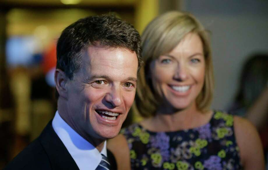 In this Aug. 5, 2014 file photo, Republican David Trott, a candidate for Michigan's 11th congressional district, stands next to his wife, Kappy, during an interview at his election night party in Troy, Mich. In a statement Monday, Sept. 11, 2017, Rep. Dave Trott, R-Mich., says he will not seek re-election. (AP Photo/Carlos Osorio) Photo: Carlos Osorio, STF / Copyright 2017 The Associated Press. All rights reserved.