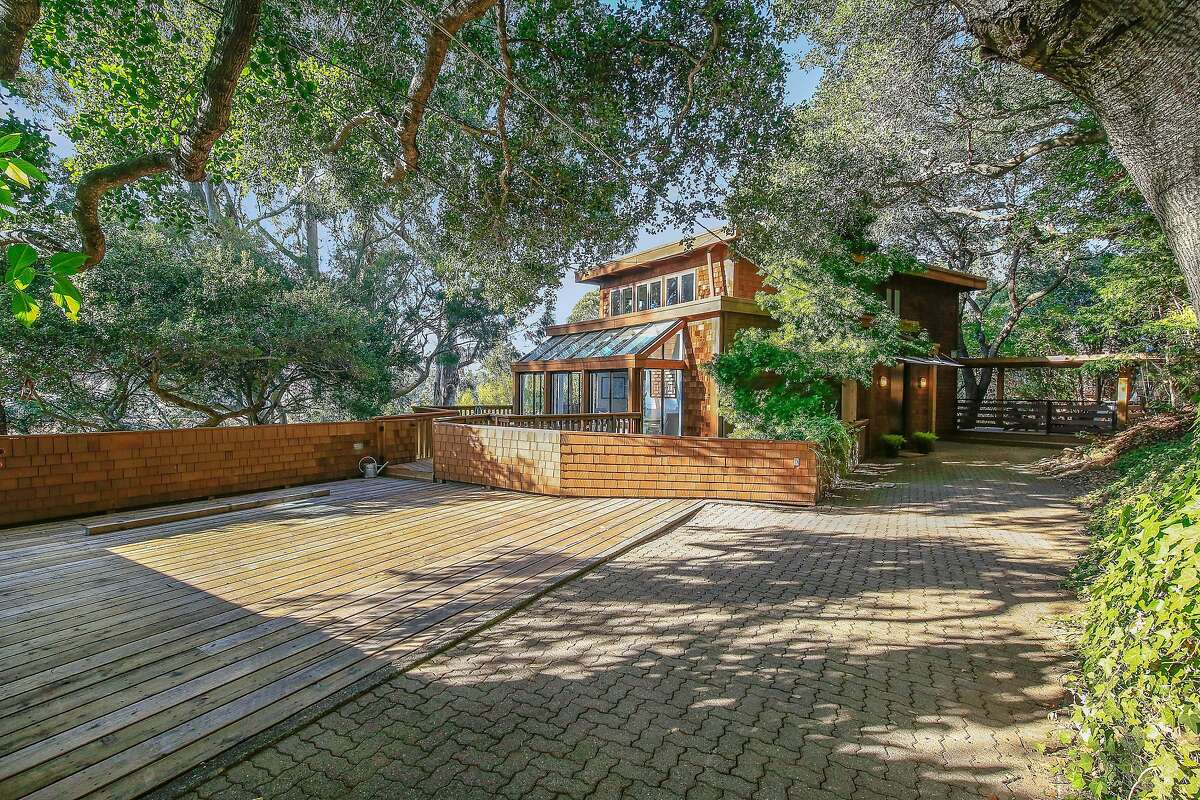 A wood deck and a brick patio stretch beside the San Anselmo home.�