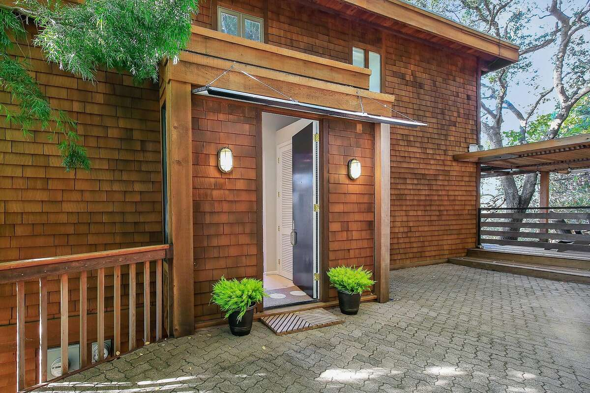 A brick patio stretches before the front door.�