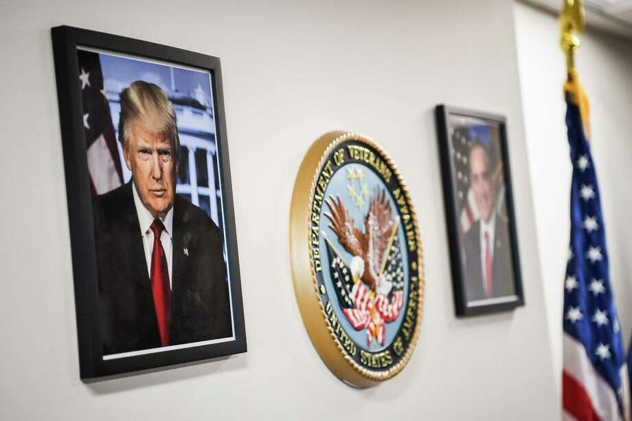A framed portrait of President Trump - downloaded from the White House website - hangs in the lobby of the Department of Veterans Affairs offices in Washington. Photo: Washington Post Photo By Salwan Georges / The Washington Post