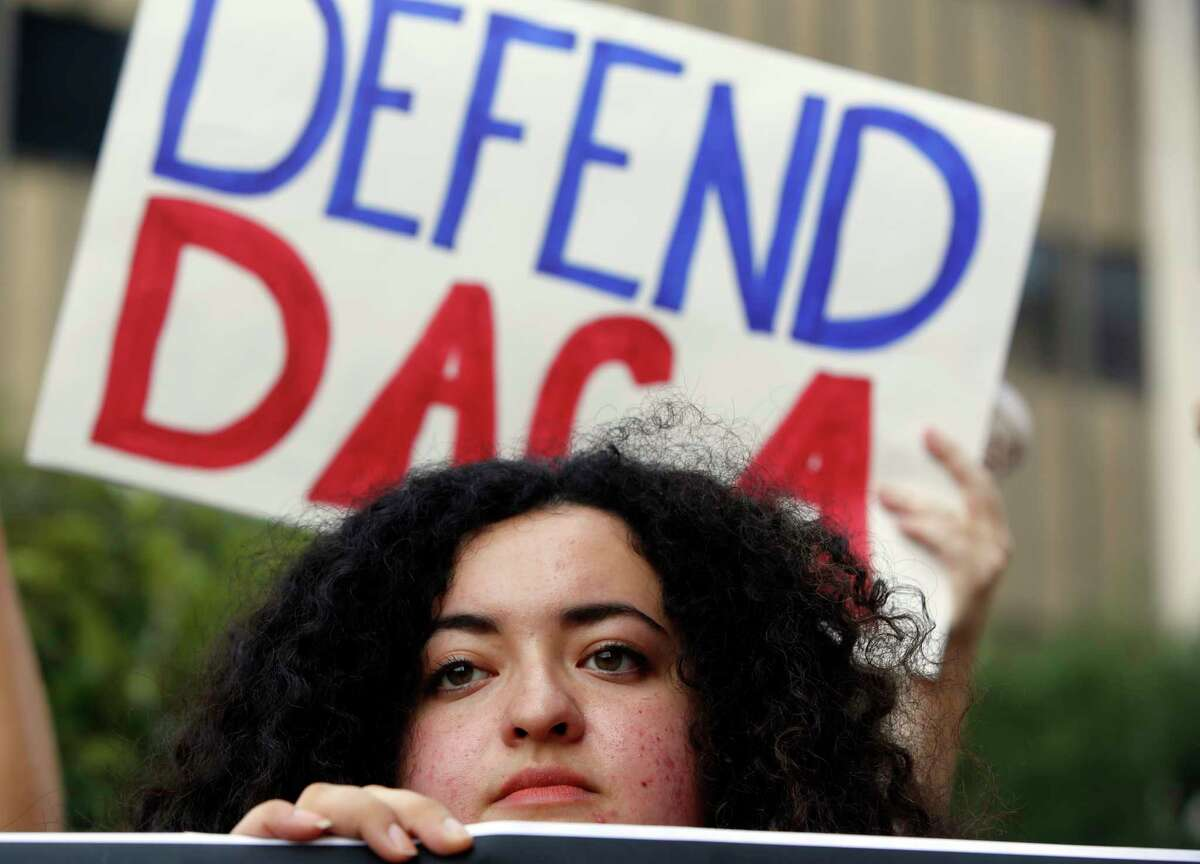 FILE - In this Sept. 1, 2017 file photo, Loyola Marymount University student and dreamer Maria Carolina Gomez joins a rally in support of the Deferred Action for Childhood Arrivals, or DACA program, outside the Edward Roybal Federal Building in Los Angeles. California Attorney General Xavier Becerra filed a lawsuit Monday, Sept. 11, against the Trump administration over its decision to end a program that protects young immigrants from deportation who were brought to the U.S. illegally as children or by parents who overstayed visas. (AP Photo/Damian Dovarganes, File)