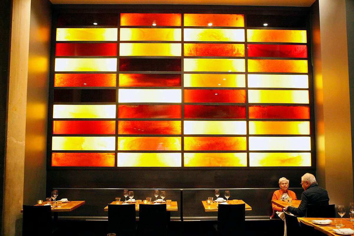 """The """"Honey Walls"""" are made of panels that contain different varieties of honey that vary in hues creating a colorful backdrop at Charles Phan's new restaurant Coachman on Mission St. in San Francisco, CA, Thursday, March 6, 2014."""