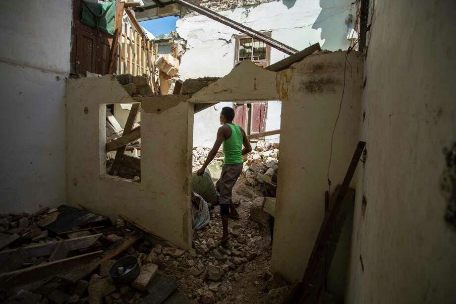 A man surveys his collapsed apartment building where two people died during the passing of Hurricane Irma in Havana, Cuba, on Monday. Cuban state media reported 10 deaths. Photo: Desmond Boylan, STR / Copyright 2017 The Associated Press. All rights reserved.