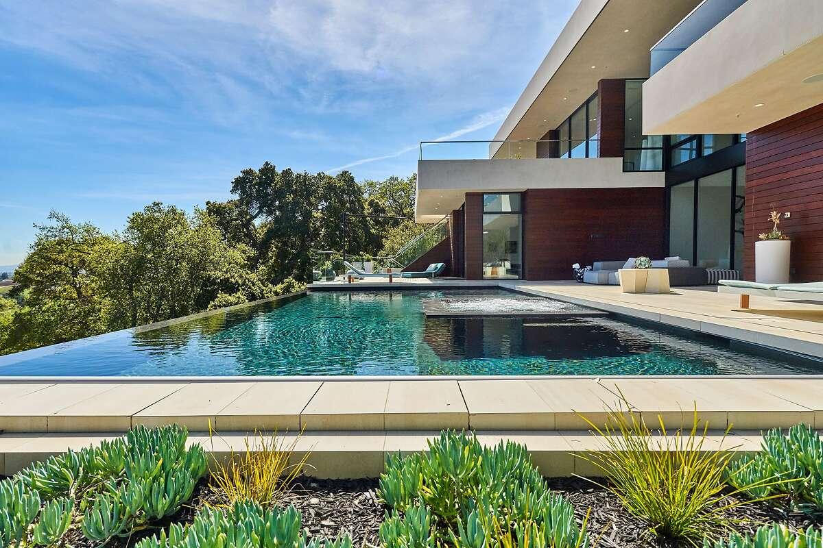 An infinity edge pool overlooks the Los Altos Hills landscape.�