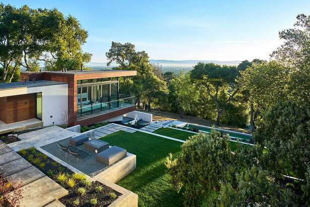 Solar panels top the roof of the Los Altos Hills home.�