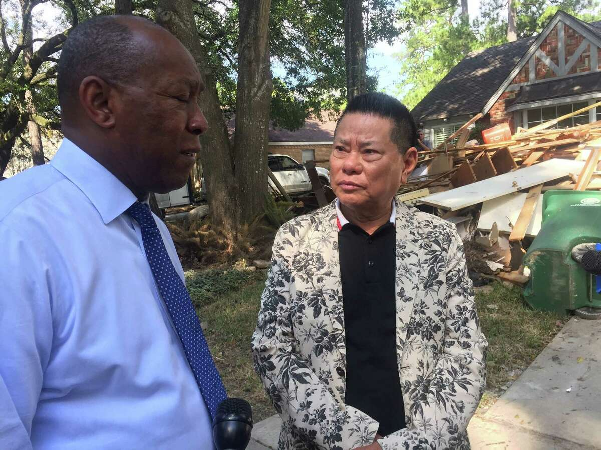 Kieu Hoang, a Vietnamese billionaire who founded a $14 billion health care company after migrating to the U.S., speaks with Houston Mayor Sylvester Turner. Hoang donated $5 million in relief funds for Houston.
