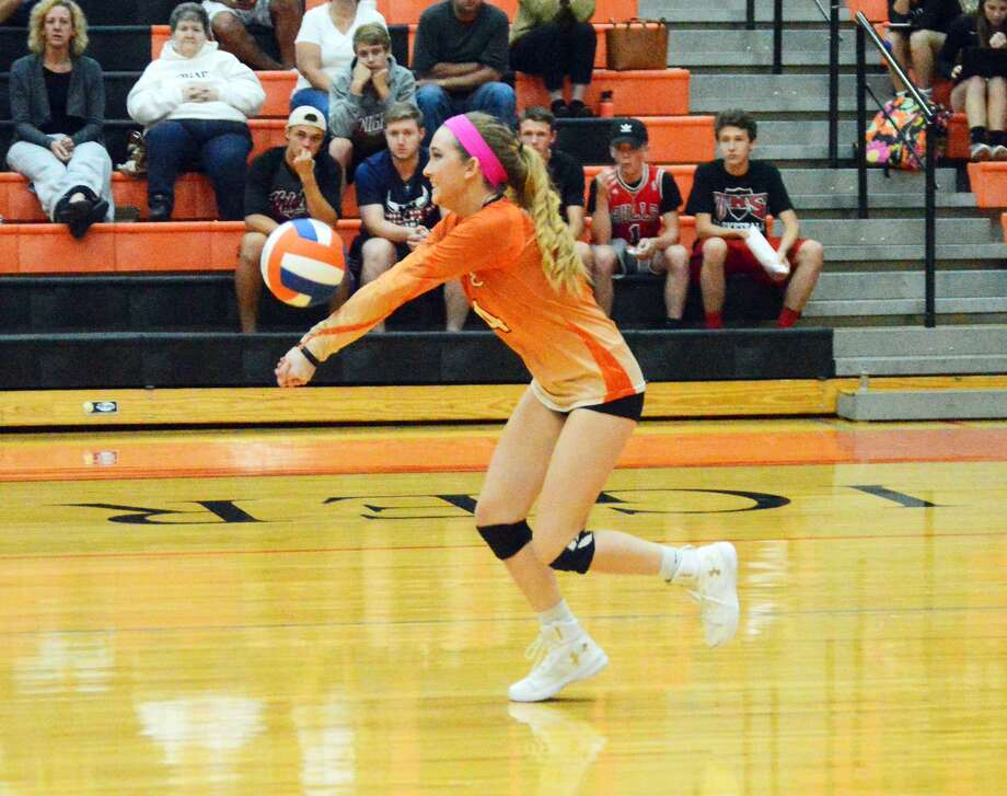 Edwardsville senior Delaney Allen bumps a ball during the second game against Triad.