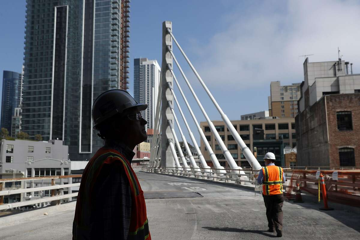 Jack Adams, Construction Manager Oversight, and Dennis Turchon, Senior Construction Manager, left, look out the entry where buses will enter at the site of the new Transbay Terminal which is still under construction in San Francisco, on Wednesday, August 23, 2017.at the site of the new Transbay Terminal which is still under construction in San Francisco, on Wednesday, August 23, 2017.