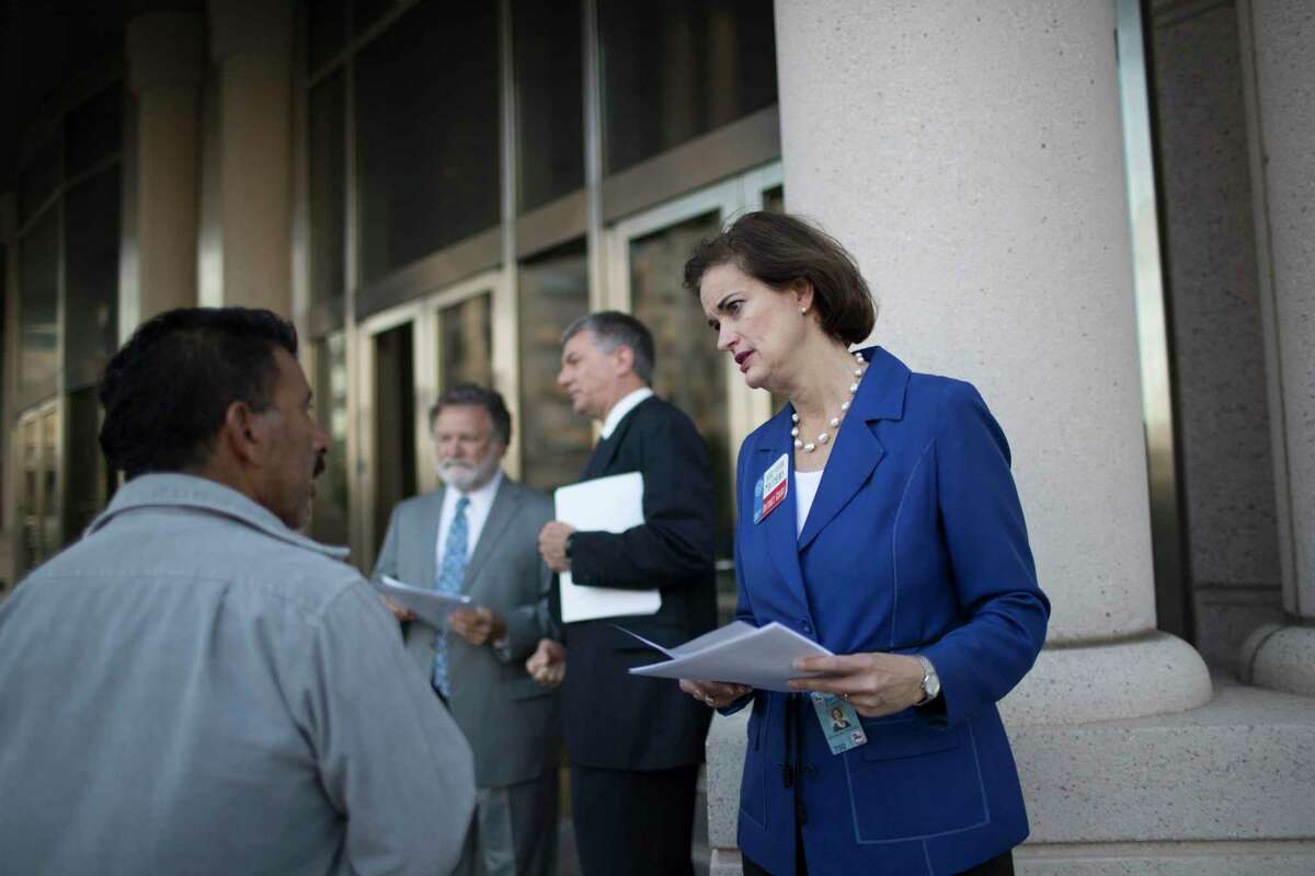 Judge Sylvia Matthews, right, provides directions to the different courts inside the Harris County Civil Court after the felony cases were moved from the criminal court to the civil.