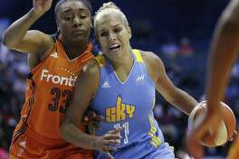 In this July 22, 2016, file photo, Chicago Sky forward Elena Delle Donne, right, drives as Connecticut Sun forward Morgan Tuck defends during a WNBA basketball game in Rosemont, Ill. Tuck will step onto the Team USA practice court later this month.