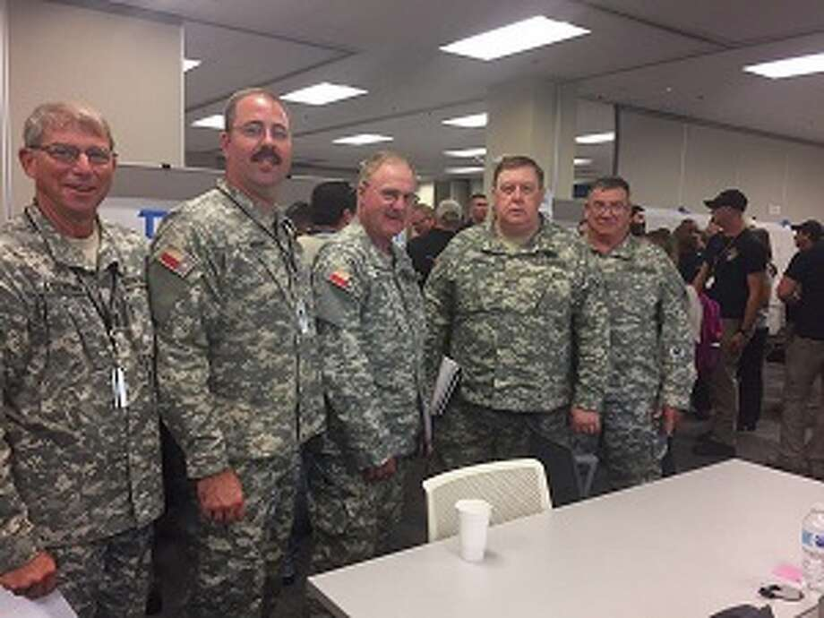 In this undated photo, Texas state Rep. Cecil Bell Jr., R-Magnolia, second from right, stands with other Texas State Guard members after being called to duty to inspect water facilities for damage from Hurricane Harvey. Photo: Handout