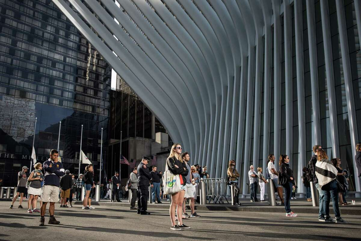 People gathered outside the World Trade Center Oculus for a moment of silence just before 9 a.m. outside the 9/11 Memorial where an official ceremony was about to begin in lower Manhattan, Sept. 11, 2017. Monday is the 16th anniversary of the terror attacks on the World Trade Center in New York, the Pentagon and the Flight 93 crash site in Pennsylvania. (Damon Winter/ The New York Times) 9/11, SEPT. 11, ANNIVERSARY, WORLD TRADE CENTER, PENTAGON, 911ANV16, NEW YORK CITY ORG XMIT: NYT18