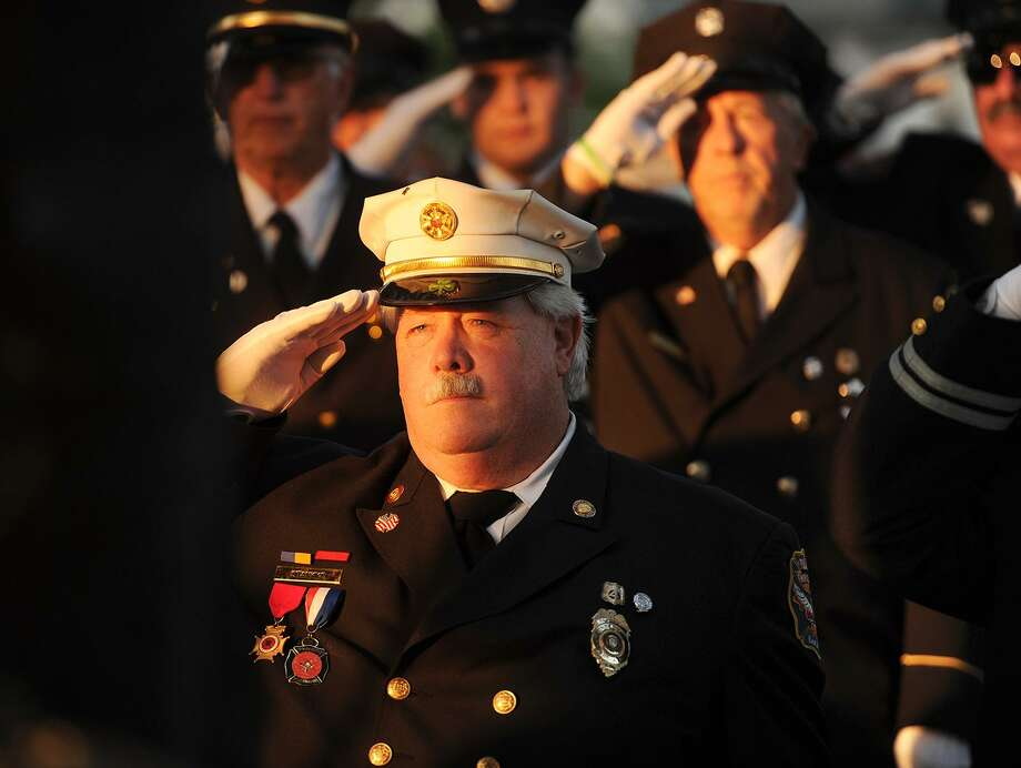 Charles Stankye, past chief of Paugassett Hook and Ladder Co. #4  in Derby, salutes with his fellow Valley firefighters during the annual 9/11 memorial ceremony at the 9/11 Memorial on the Derby Green in Derby, Conn. on Monday, September 11, 2017. Photo: Brian A. Pounds / Hearst Connecticut Media / Connecticut Post