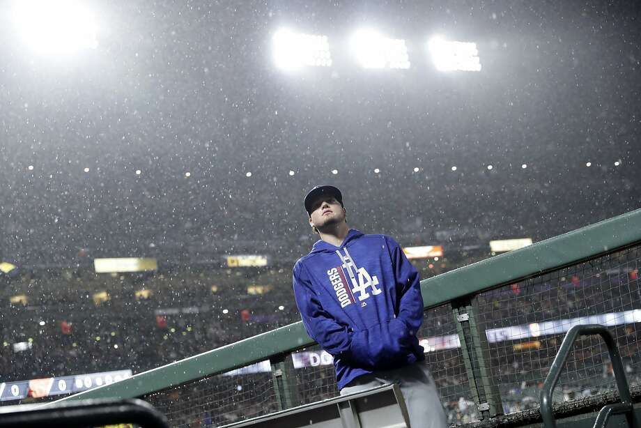 Los Angeles Dodgers' Alex Verdugo looks up at the rain during a delay during a baseball game against the San Francisco Giants, Monday, Sept. 11, 2017, in San Francisco.  Photo: Marcio Jose Sanchez, Associated Press