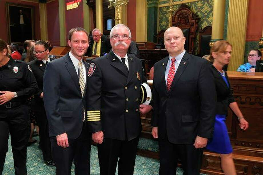 State Rep. Gary Glenn, of Midland, right, joins guest Midland Fire Chief Chris Coughlin, center, and House Speaker Tom Leonard, of DeWitt, today for the Michigan House's annual Sept. 11 Memorial Service at the Capitol. The ceremony remembers first responders and members of the military from Michigan who died in the line of duty in the past year.