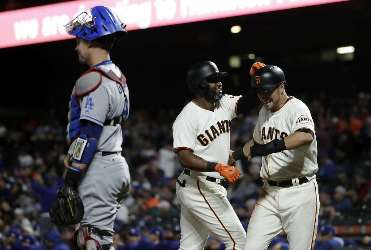 San Francisco Giants' Denard Span, center, celebrates his two-run home run with teammate Joe Panik, right, during the first inning of a baseball game against the Los Angeles Dodgers Monday, Sept. 11, 2017, in San Francisco. (AP Photo/Marcio Jose Sanchez)