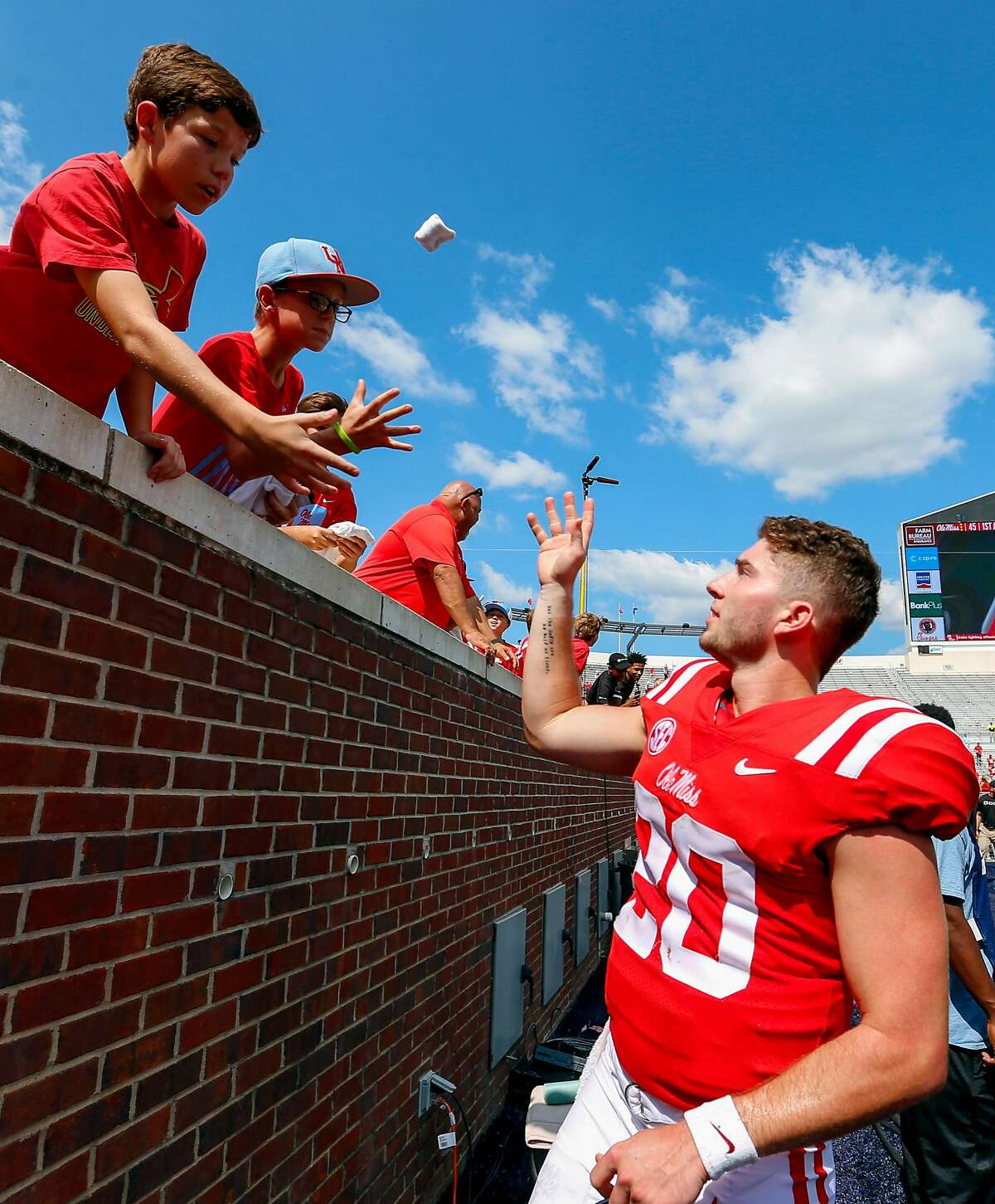 OXFORD, MS - SEPTEMBER 9: Quarterback Shea Patterson #20 of the Mississippi Rebels tosses his armbands to some fans after they defeated the Tennessee Martin Skyhawks 45-23 in an NCAA football game at Vaught-Hemingway Stadium on September 9, 2017 in OXFORD, Mississippi. (Photo by Butch Dill/Getty Images)