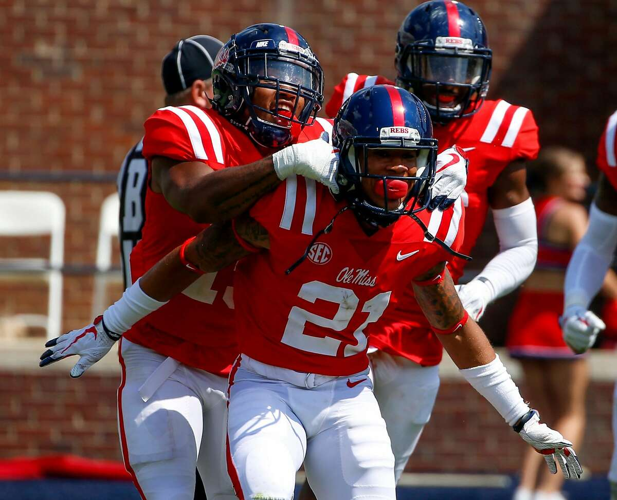 OXFORD, MS - SEPTEMBER 9: Defensive back Javien Hamilton #21 of the Mississippi Rebels celebrates after he intercepted a pass during the second half of an NCAA football game against the Tennessee Martin Skyhawks at Vaught-Hemingway Stadium on September 9, 2017 in OXFORD, Mississippi. (Photo by Butch Dill/Getty Images)