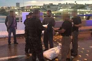 "Juan Rafael ""El Cubano"" Arredondo Oviedo is handed over to Mexican authorities at one of Laredo's international bridges. He is accused of taking part in the infamous Allende Massacre."