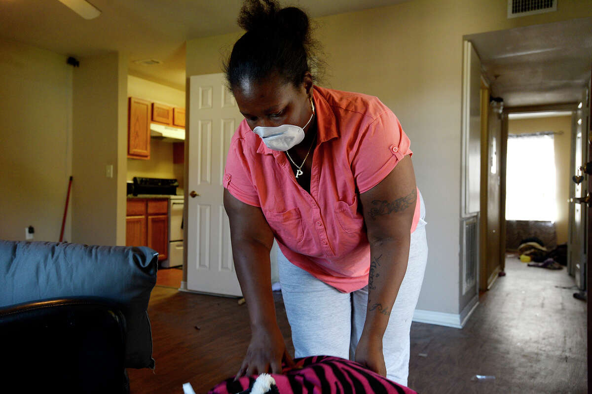 Phoebe Cormier packs items out of her Sunlight Manor apartment in Beaumont on Monday. Cormier stayed with family in Jennings, La. after the flood, but returned to clean out her damaged apartment. She has been staying in the Red Roof Inn. Photo taken Monday 9/11/17 Ryan Pelham/The Enterprise