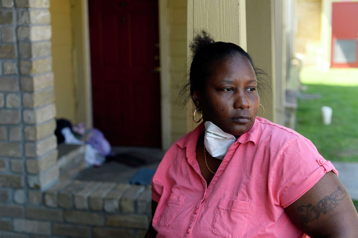 Phoebe Cormier takes a break from cleaning out her Sunlight Manor apartment in Beaumont on Monday. Cormier stayed with family in Jennings, La. after the flood, but returned to clean out her damaged apartment. She has been staying in the Red Roof Inn. Photo taken Monday 9/11/17 Ryan Pelham/The Enterprise